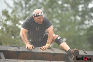 Climbing over obstacle at a Spartan Sprint